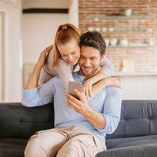 Close up of a young couple using smart phone